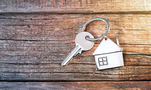 A key on a house-shaped keychain