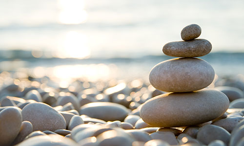 A stack of four stones on a stoney beach